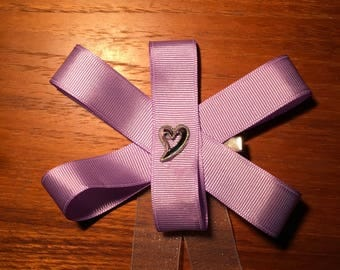 Purple sparkle with a silver heart hand crafted hair bow