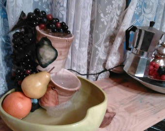 Tabletop fruit themed water fountain.