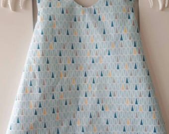 Light blue overooier with triangles/asterisks. Reversible. Baby girls dress pinafore dress size 50-56.