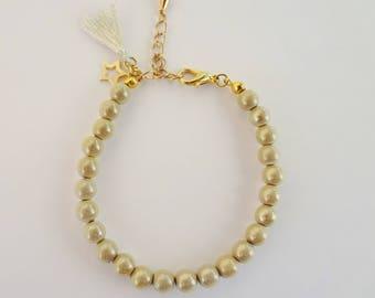 Bracelet beaded tackled women Ostrea ivory gold