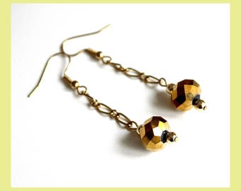 Golden chain and crystal earrings