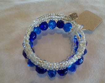 Memory Wire Bracelet.  Clear seed beads with Royal blue accents