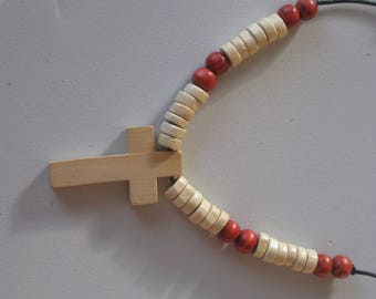 Hand carved wood cross pendant and wood beads from Africa.