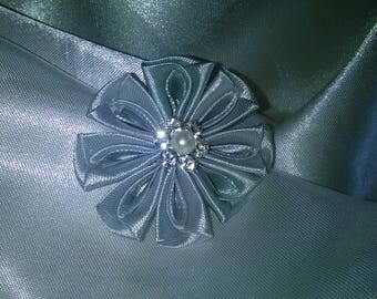fabric flower made with a Silver Cup and iridescent Pearl gray satin ribbon