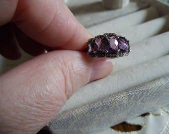 3 purple amethyst stone set in silver size 8.