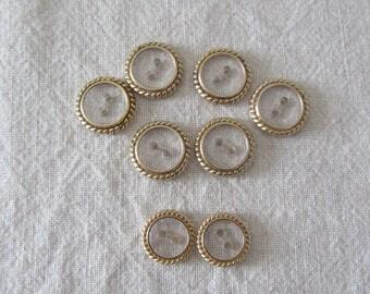 Flat gold rimmed transparent buttons