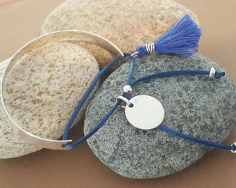 flat band with sterling silver medal in silver thread and tassel