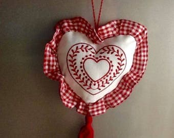 Embroidered heart and red gingham fabric