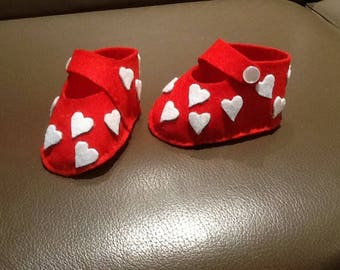 White hearts and red felt baby shoes