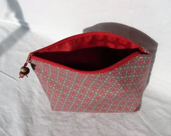 Coated canvas zippered pouch.