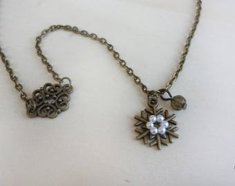 bronze necklace with snowflake sprinkled with perlline & charms