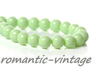 pretty pastel green glass with 6mm 20 beads