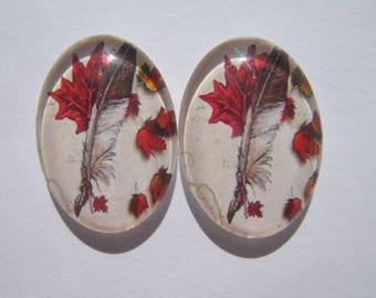 Pretty set of two oval 25 X 18 mm with images of feathers Burgundy Red glass cabochons