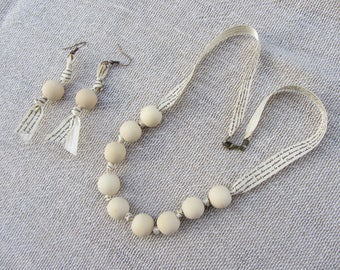 """adornment necklace and Earring set with wide ribbon large round natural wooden beads and ecru print """"writing"""""""