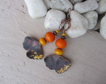Antiqued copper ginkgo leaf earrings plant, and bright orange and yellow handmade Lampwork Glass Beads