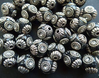 4 Indonesian beads 14 mm black 2 mm hole