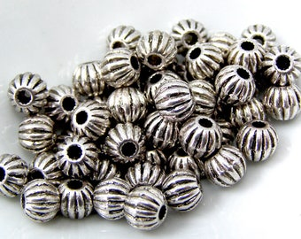 Round beads zinc separator silver 6 mm hole 1 mm set of 10