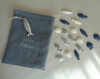 decorative seaside set of 18 small cold ceramic fish in a blue gray linen bag