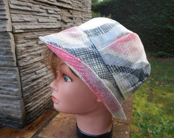 Hat was a brimmed reversible