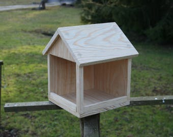 A wooden bird feeder