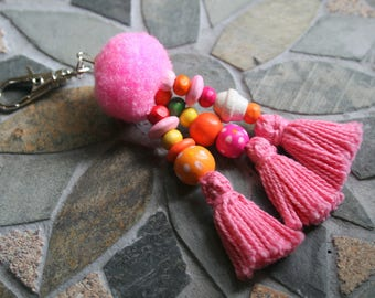 Bag charm with wooden beads and tassels