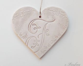 Large earthenware and lace impressions heart hanging, brown beige color, letter 'F'