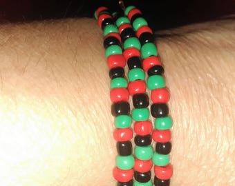 Green, Red, Black beaded bracelet with memory wire