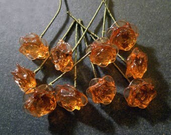 10 flowers of yellow amber glass on 35 mm flexible green stem