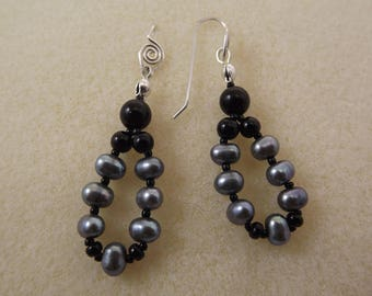 onyx and pearl, loop dangle earrings with hand-forged sterling silver earwires.