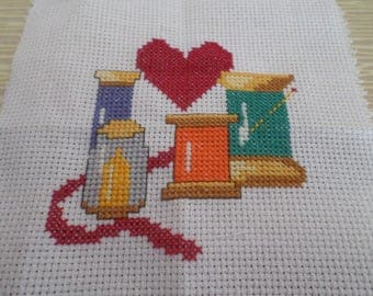 cross stitch and embroidery stitch back: spools of thread