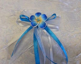 Turquoise plumeria flowers boutonniere