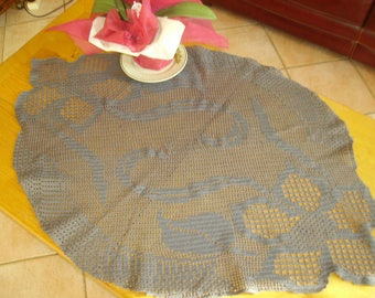 large grey doily while transparency