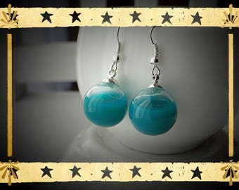 Opaque turquoise liquid filled glass globe mounted on Stud Earrings