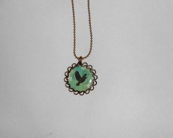 """The little black bird"" bronze necklace cabochon"