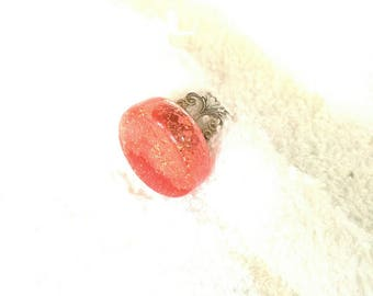 Orange round ring with liquid glass and glitter