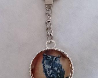 OWL Keychain facet under glass