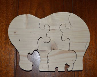 Puzzle 4 pieces of an elephant with her calf