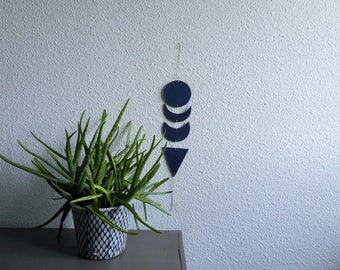Ethnic, geometric wall decoration made of four Cork icons painted in Midnight blue, connected by a string