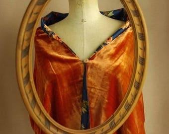 The Stella stole is orange silk velvet.
