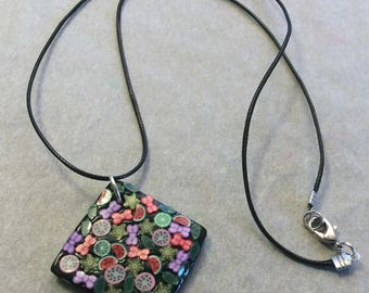 Necklace and matching colorful polymer clay ring.