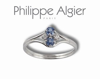 White gold ring 18 k, sapphires and diamonds.