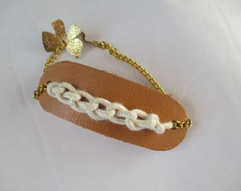 camel brown leather with gold chain and cord bracelet
