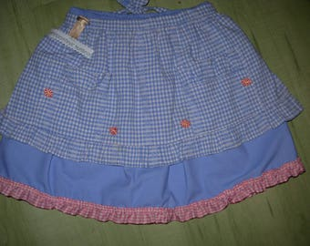 Pink girl in blue cotton ruffle skirt