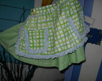 Girl in green and white gingham cotton skirt