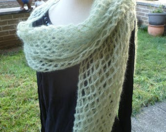 Crocheted shawl hands mohair and silk in a pretty soft green color
