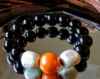 Handmade Black, orange and white beaded bracelet