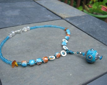 Sunrise Necklace - charming bead work. aquamarine glass beads, decorative pendant,  accents of orange