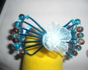 blue butterfly with pearl bracelet