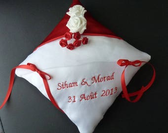 embroidered red and white cushion