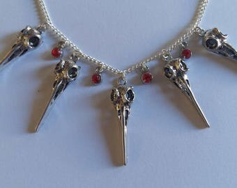 Necklace 5 red birds with diamond skulls